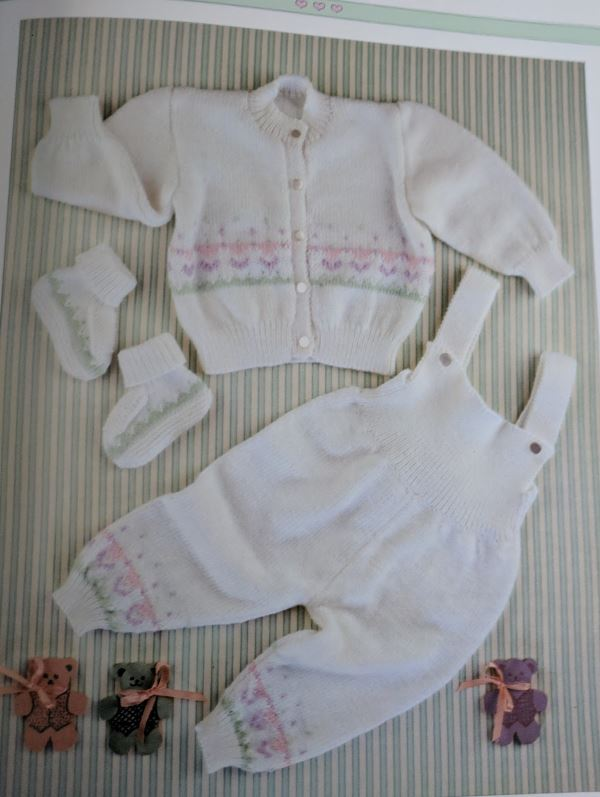 Baby knitting pattern set with cardigan overalls and booties