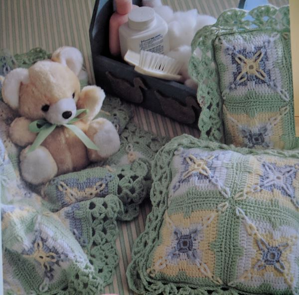 Crochet knitting pattern for a baby blanket and pillows